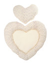 Pillow beige heart on white Stock Photos