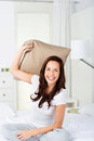 Pillow fight beautiful brunette woman in a at home Royalty Free Stock Photography