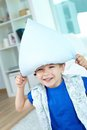 Pillow fun playful little boy having a on his head Stock Image