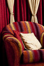 Pillow with an ornament on a red chair Royalty Free Stock Photo