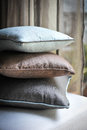 Pillow a pile of with curtain background Stock Photos