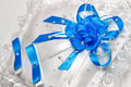 Pillow for wedding rings with blue ribbons white Royalty Free Stock Photos