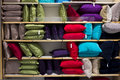 Pillows on a shelf in a store sale large colourful used for decorating red green purple blue black are some of the Royalty Free Stock Photo
