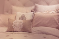 Pillows soft toned plush bed Royalty Free Stock Photos