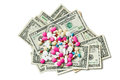 Pills on american dollars colorful white background Stock Images