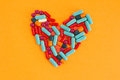 Pills arranged in heart shape Royalty Free Stock Photo