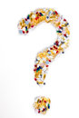 Pills as question mark on white background. Medical concept. Royalty Free Stock Photo