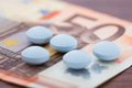 Pills on banknote closeup photo of lying euro Royalty Free Stock Photo