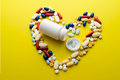Pills and capsules in heart shape with bottle Royalty Free Stock Photo
