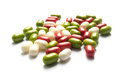 Pills colored on white background Stock Photo