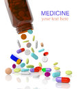 Pills come out from a medicine bottle Royalty Free Stock Images