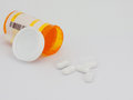 Pills and container isolated Royalty Free Stock Photos