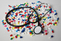 Pills and doctors stethoscope Stock Image