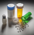 Pills drugs and bottles open medicine bottle with spilling out Royalty Free Stock Photo