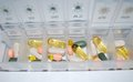 Pills drugs colored macro in container Royalty Free Stock Photo