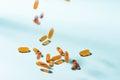 Pills falling down. Gel Capsules.  Vitamin A, E, fish oil, primr Royalty Free Stock Photo