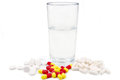 Pills and glass of water isolated Stock Photography