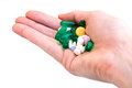 Pills in hand a holding a variety of and vitamins Stock Photos