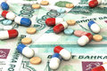 Pills lie on the background of rouble money. Medical business concept.