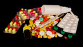 Pills and medicine closeup isolated on black background Royalty Free Stock Images