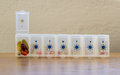 Pills organizer drugs daily dosage for one week Royalty Free Stock Photos