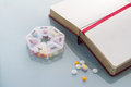 Pills planner with weekly medication capsules.jpg Royalty Free Stock Photo