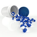 Pills spilling out of pill bottle d on white Royalty Free Stock Photo