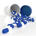 Pills spilling out of pill bottle d on white Royalty Free Stock Photography