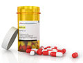 Pills spilling out of pill bottle Royalty Free Stock Photo