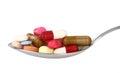 Pills on spoon Stock Image