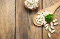 Pills on spoon with leaves a wooden background Stock Photography