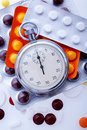 Pills and stopwatch Royalty Free Stock Image
