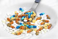 Pills and tablets a bunch of multicolored in a plate Stock Photo