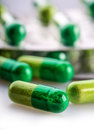 Pills. Tablets. Capsule. Heap of pills. Medical background. Close-up of pile of yellow green  tablets Royalty Free Stock Photo