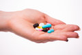 Pills, tablets, vitamins and drugs heap in woman hands Royalty Free Stock Photo