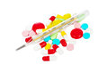Pills and thermometer Royalty Free Stock Photo