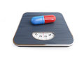 Pills for weight loss floor scale Royalty Free Stock Photo