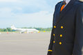 Pilot on the airfield place for your text Stock Image