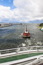 Pilot boat pushs cruiser at operation on the baltic sea Stock Photo