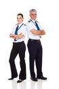 Pilot and co pilot senior female full length portrait on white Royalty Free Stock Image