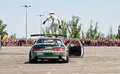 Pilot drift team x round performs risky stunt climbs to the roof volgograd june of car while driving june in volgograd russia Royalty Free Stock Images
