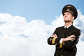 Pilot is in the form of arms crossed folded against sky with clouds Stock Photos
