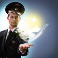 Pilot in the form of extending a hand to a flying airplane with sky clouds and sun Royalty Free Stock Photography