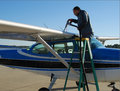 Pilot refueling small airplane Royalty Free Stock Photo