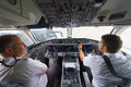 Pilots in aircraft cockpit geneva september etihad regional on september geneva switzerland darwin airline operating under the Stock Photos