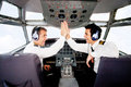 Pilots in an airplane cabin Stock Photos