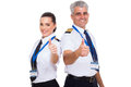 Pilots thumbs up cheerful airline giving over white background Royalty Free Stock Photos