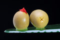 Pimento stuffed green olives on black side and bottom view of two salad with red background Stock Photos