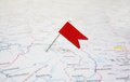 Pin flag with red stuck in a map Stock Photography