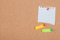 Pin on memo paper on cork board Royalty Free Stock Photo